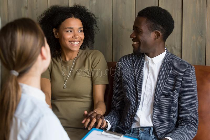 Happy African American couple reconciled after successful psycho stock image