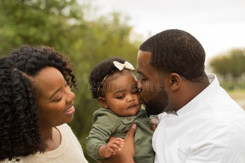 Happy African American family with their baby. stock photo