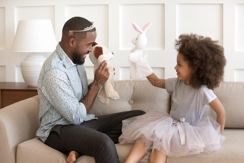 Happy african american father dressed like princesses with little daughter. stock images