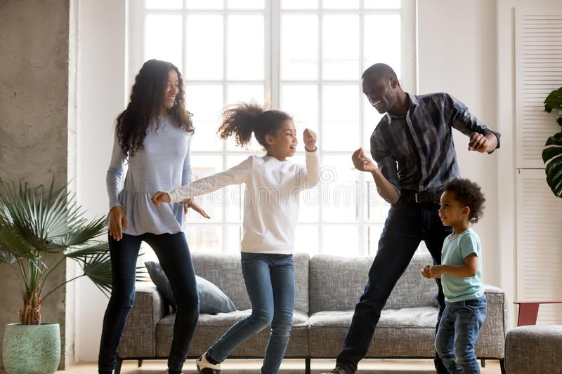 Happy African American having fun together indoors stock photos