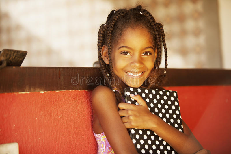 Happy african american little girl with tablet royalty free stock images