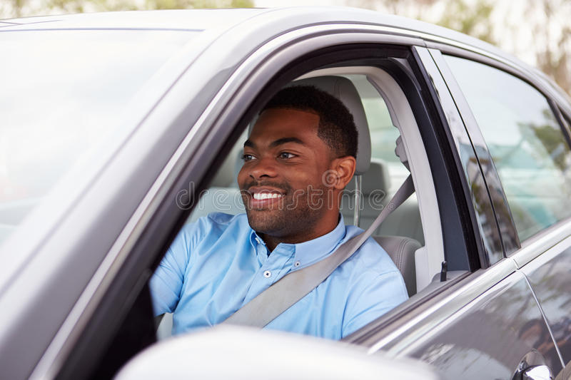 Happy African American male driver in car royalty free stock photo