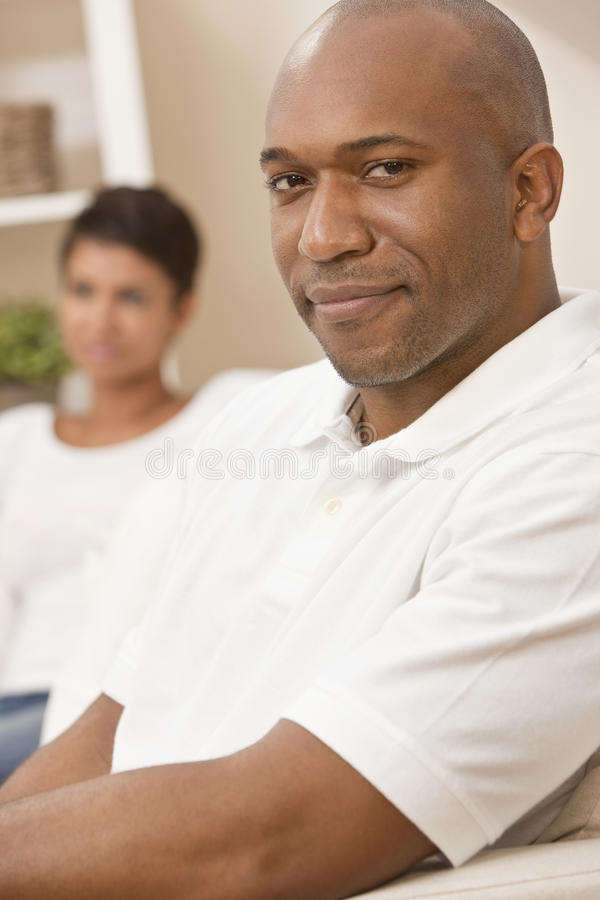 Download Happy African American Man Sitting At Home Stock Image - Image: 18992279