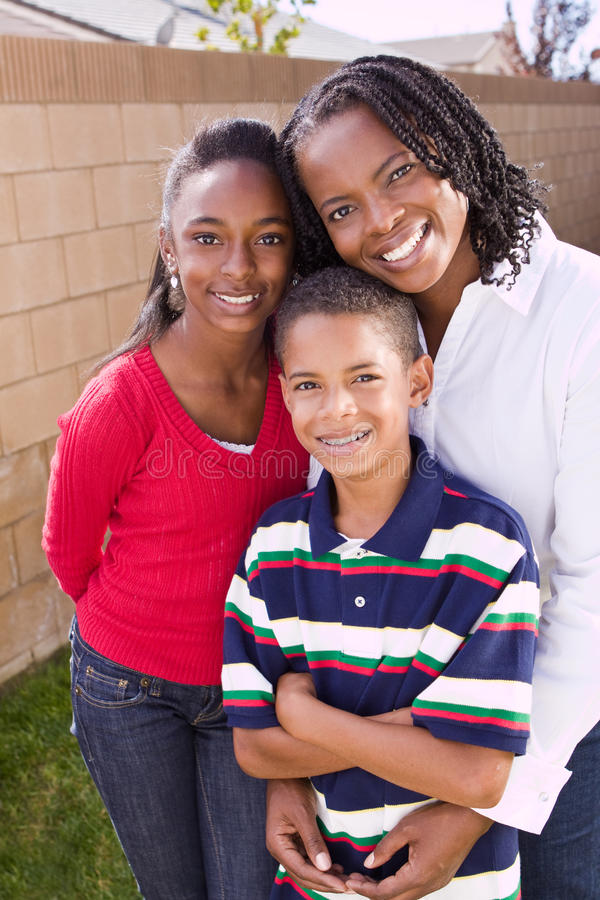 Happy African American mother and her children. royalty free stock photos