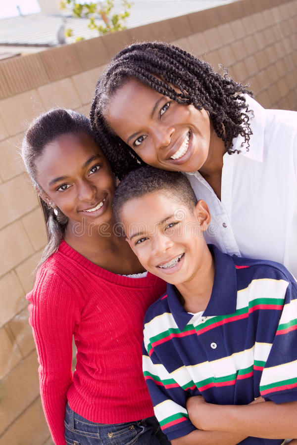 Happy African American mother and her children. stock photos