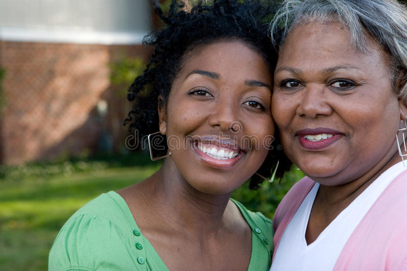 Happy African American mother and her daugher. stock photography
