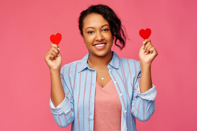 Happy african american woman with red hearts stock photo