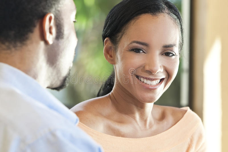 Happy African American Woman Smiling To Camera stock photo