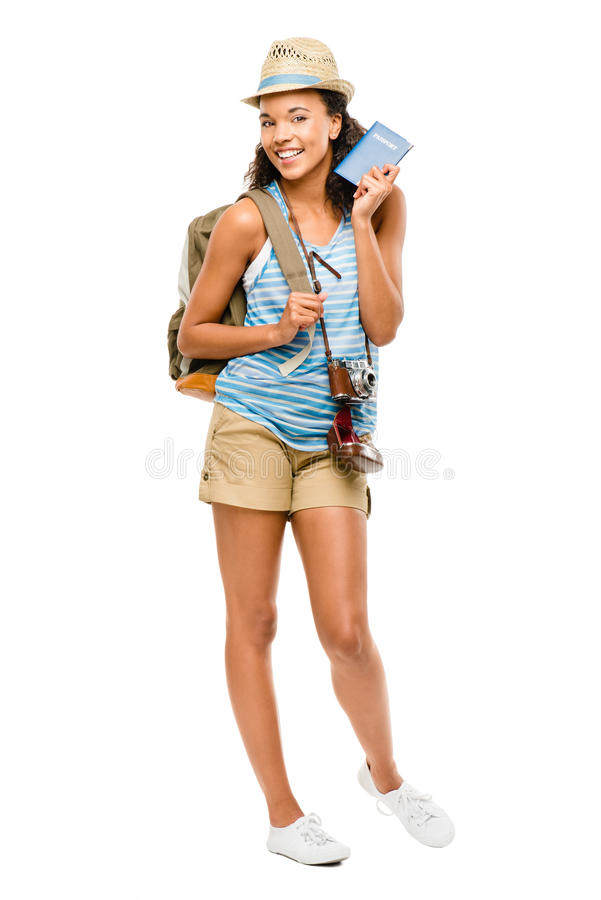 Happy African American woman tourist holding passport royalty free stock photo