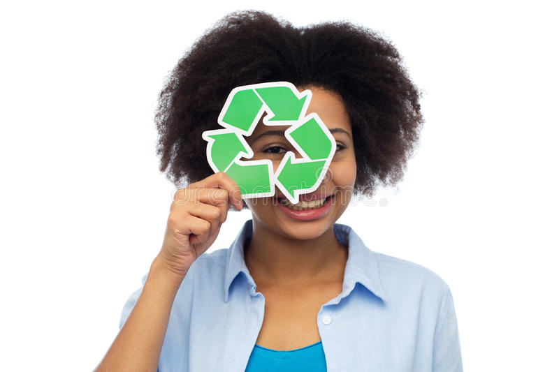 Happy african american young woman over white. People, ecology, conservation and recycling concept - happy african american young woman looking through recycle stock photo