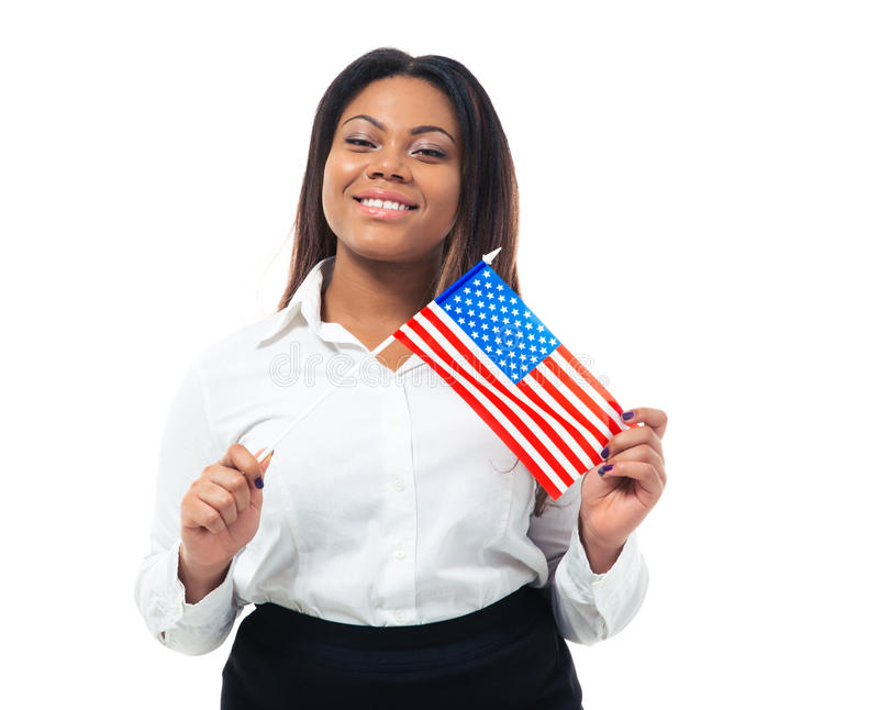 Happy african busiensswoman holding US flag. Isolated on a white background. Looking at camera royalty free stock photo
