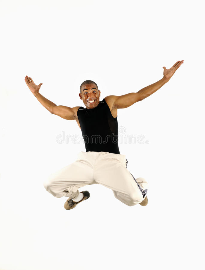 Happy African Guy Jumping Stock Images