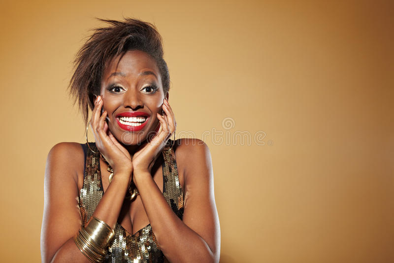 Happy african woman looking. Smiling young african woman looking happy and surprised stock image