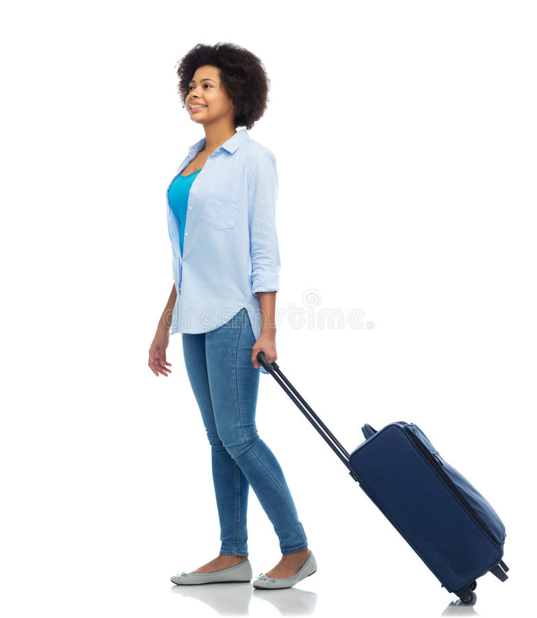 Happy afro american woman with carry-on travel bag. People, travel, tourism and vacation concept - happy afro american young woman with carry-on bag over white stock photo