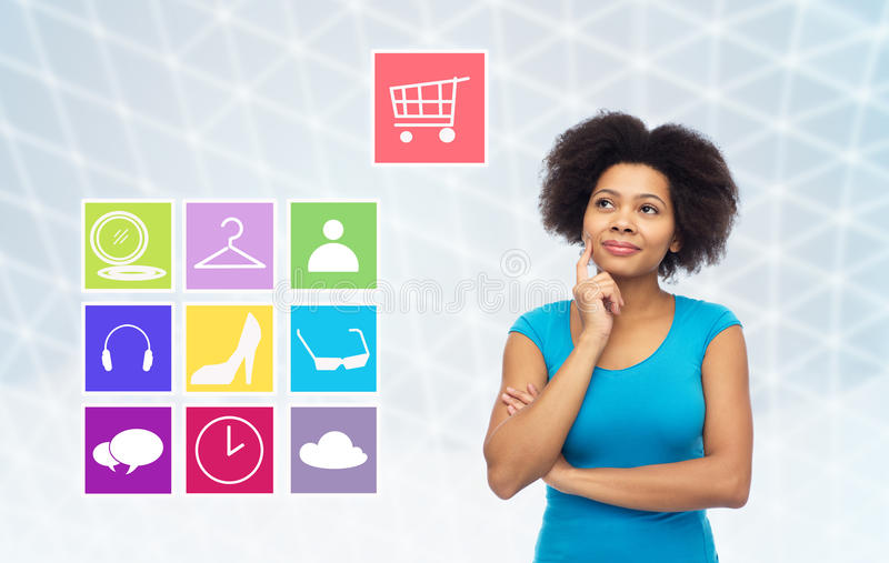 Happy afro american young woman with menu icons royalty free stock photo