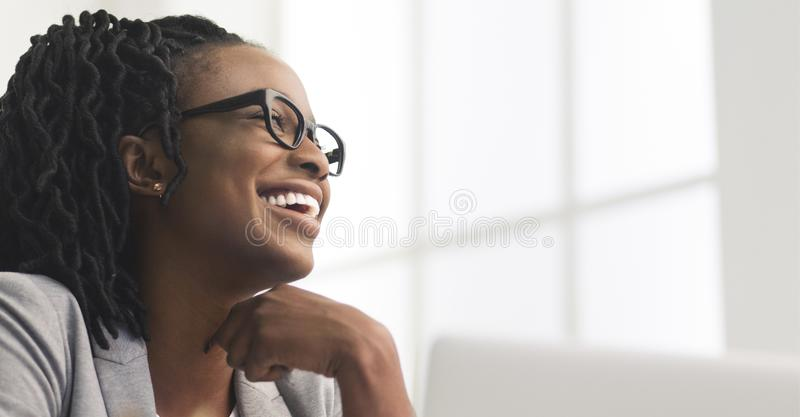 Happy Afro Business Woman Having Rest, Sitting On Workplace stock photos