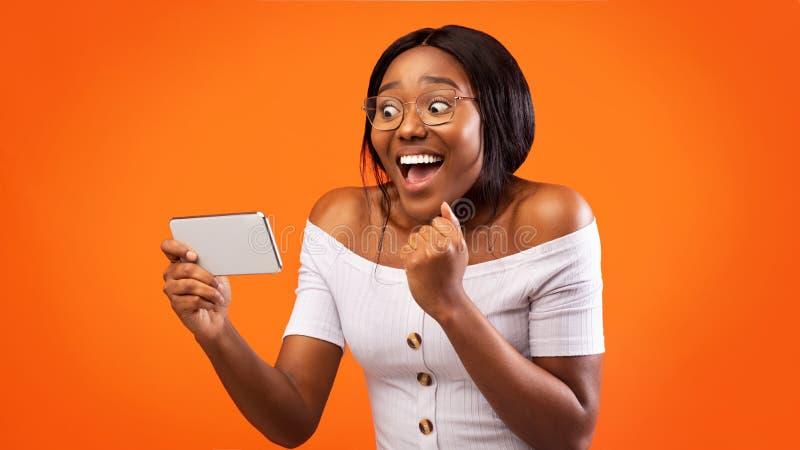 Happy Afro Girl Holding Cellphone Gesturing Tak, Orange Background, Panorama zdjęcia royalty free