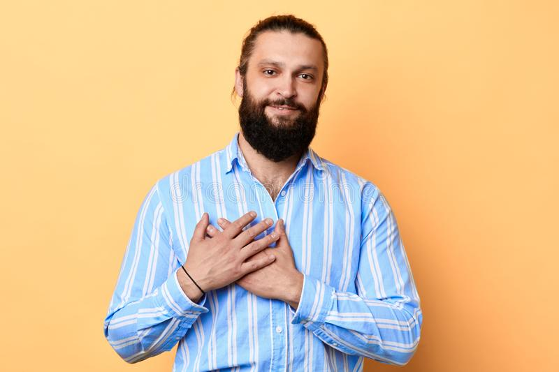 Happy amazed young bearded man expresses his warm feeling to girlfriend stock photography