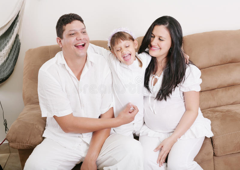 Happy American Family Playing with daughter in the living room royalty free stock photography