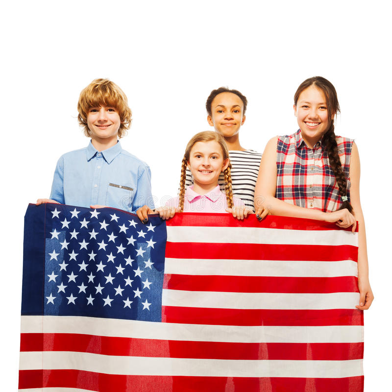 Happy American kids with the star-spangled banner. Four happy multiethnic teenage kids holding the star-spangled banner, isolated on white stock photo