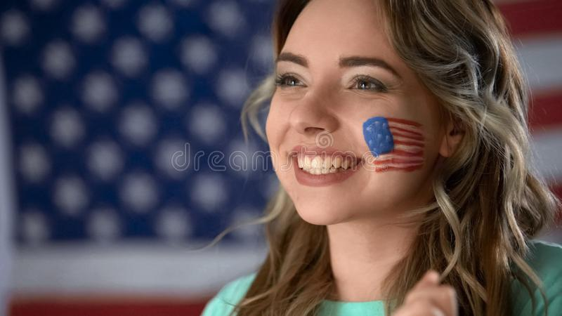 Happy American woman supporting political candidate, celebrating victory closeup stock photo