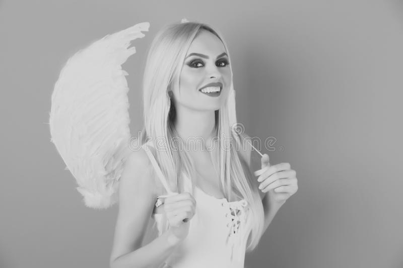 Happy angel woman with blond hair and makeup in wings stock photos