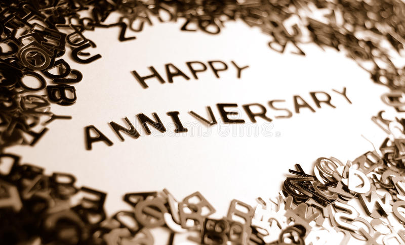 Happy anniversary. Message made from miniature letters (monochrome stock image