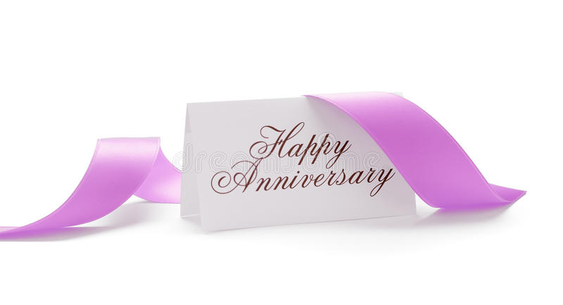 Happy anniversary card. With a pink ribbon over a white background stock photos