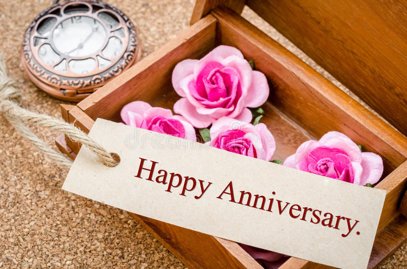 Happy Anniversary card. Happy Anniversary card and pink rose with vintage pocket watch on wood background stock photos