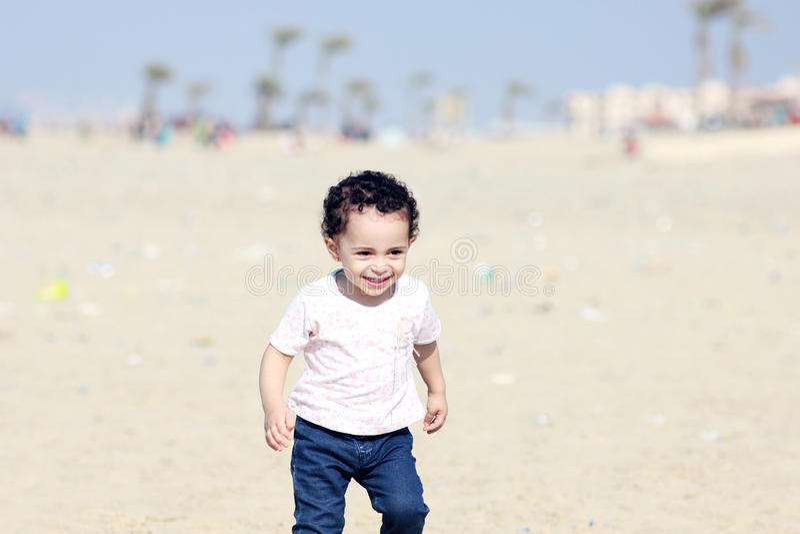 Happy arab baby girl stock photo