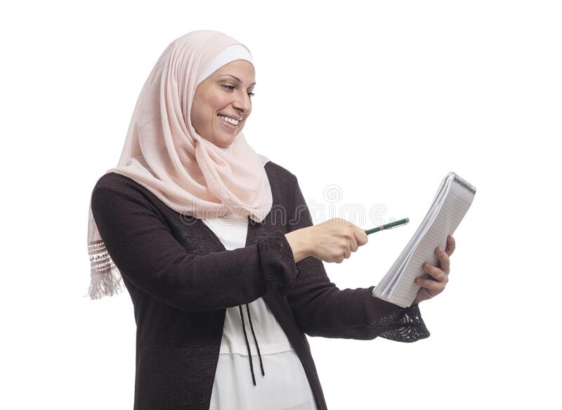 Happy Arab Muslim businesswoman found a solution dressed in traditional Islamic clothing royalty free stock photography