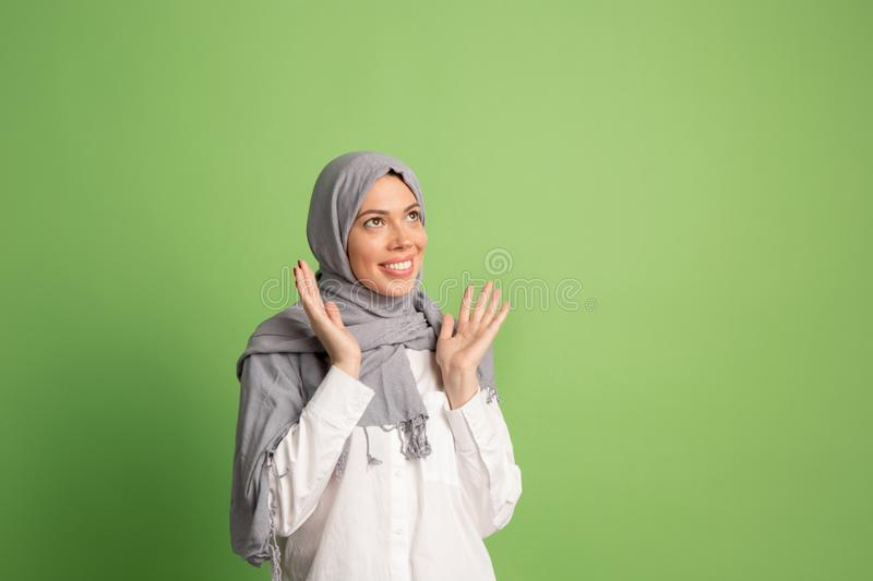 Happy arab woman in hijab. Portrait of smiling girl, posing at studio background stock photos