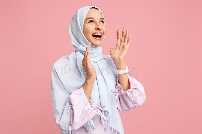 Happy arab woman in hijab. Portrait of smiling girl, posing at studio background stock photography