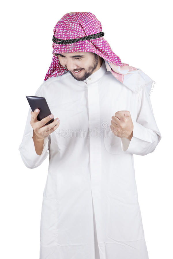 Happy Arabic entrepreneur reads message stock image