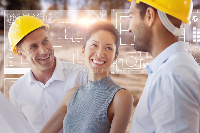 Composite image of happy architect discussing over blueprint royalty free stock photo