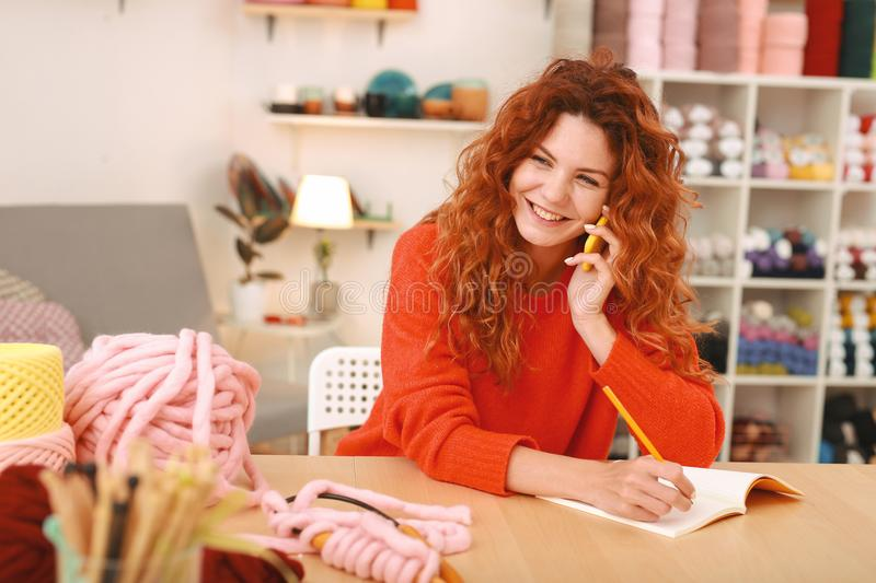 Happy art worker smiling while receiving birthday wishes stock photography