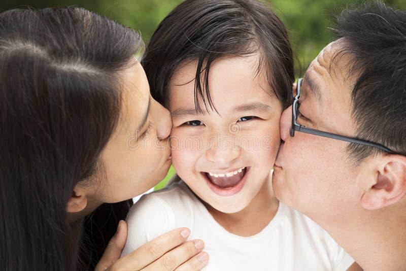Happy asain family. In kissing
