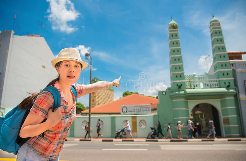 Happy Asia woman Travel in Singapore, Masjid Jamae royalty free stock image