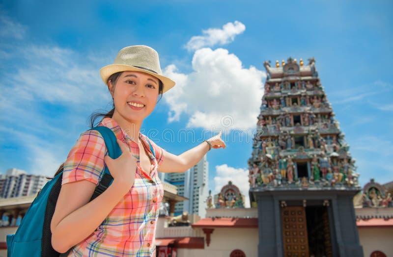 Happy Asia woman Travel in Singapore, Sri Mariamman Temple. Happy Asia woman Travel in Singapore, Pointing Sri Mariamman Temple royalty free stock photo