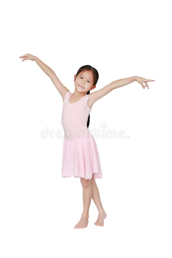 Happy Asian ballet dancer girl in pink tutu skirt isolated on white background. Little child girl dreams of becoming a ballerina royalty free stock image