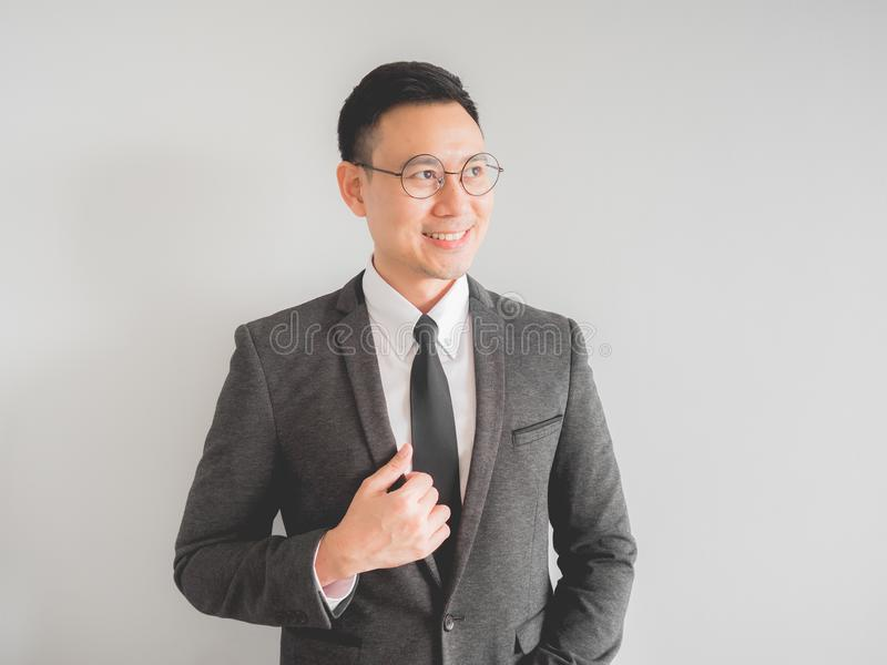 Happy and relax boss manager business man in black suit. Happy Asian boss manager business man wears black suit in relax pose royalty free stock images