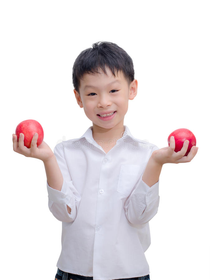 Happy Asian boy with apple royalty free stock image