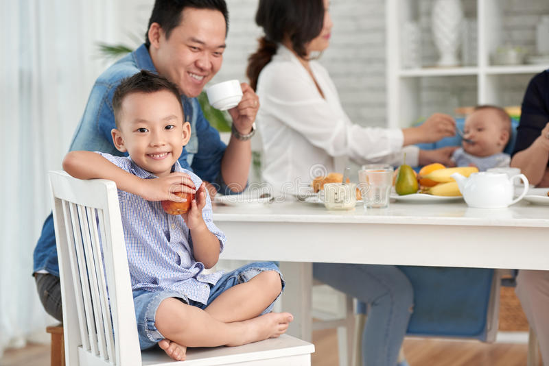 Happy Asian Boy at Breakfast with Family stock images