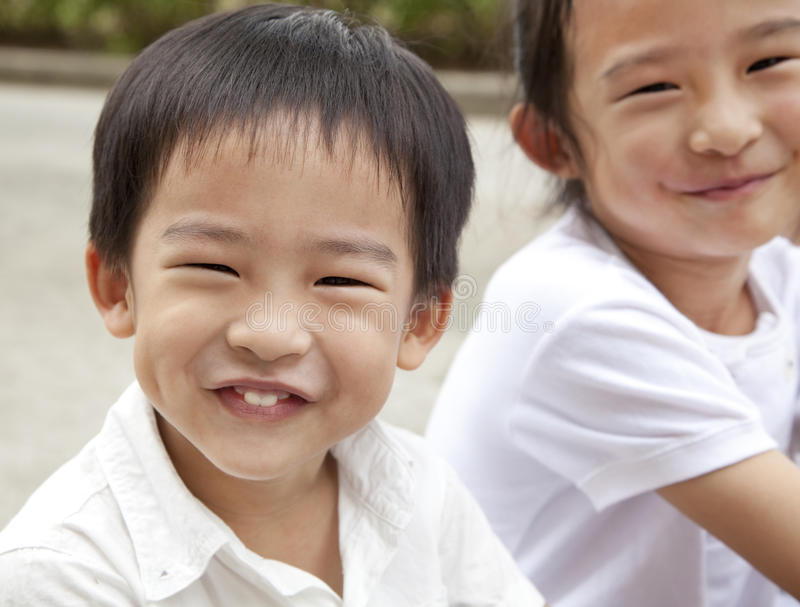 Happy asian boy and girl. Smiling asian boy and girl stock image