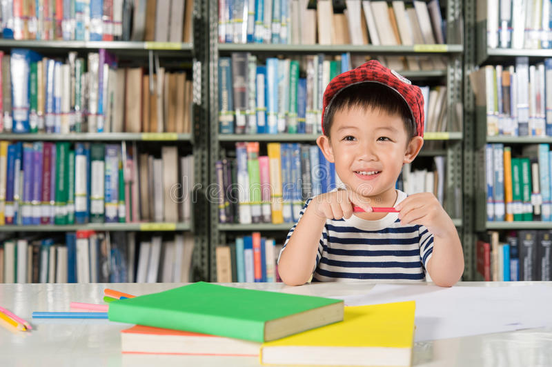 Happy Asian Boy in library room school when he study stock photo