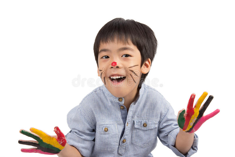 Happy asian boy with painted face stock photo