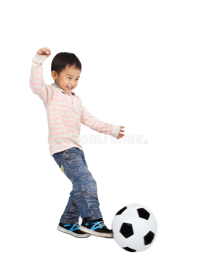 Happy asian boy playing soccer royalty free stock photography