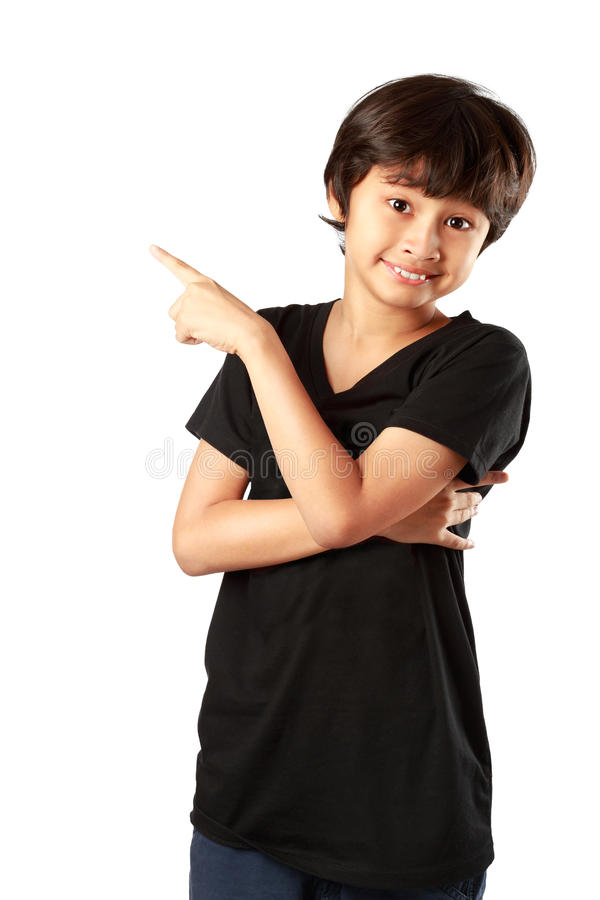 Happy asian boy pointing up stock photos