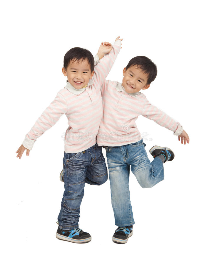 Happy asian boys. Dancing together stock photos