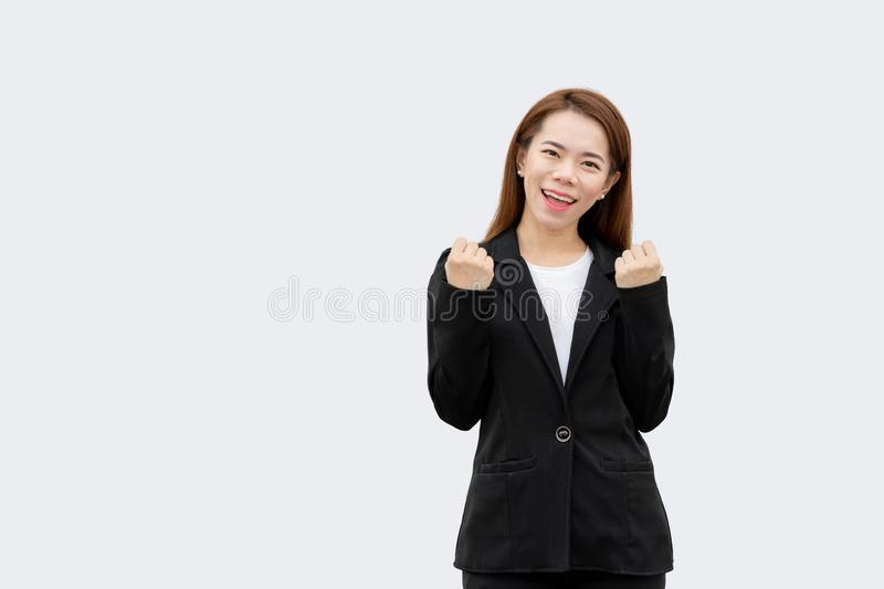 Happy asian business woman arms up in black suit isolated on white color background royalty free stock photo